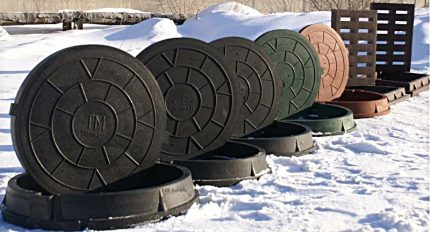 Sewer manholes in the snow
