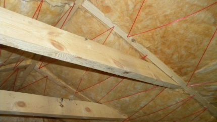 Fixing mineral wool with thread