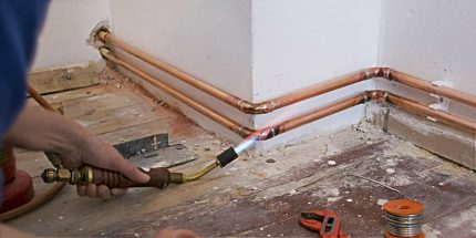 The master solders copper pipes