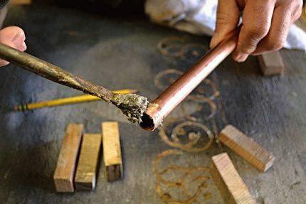 Master fluxes a copper pipe
