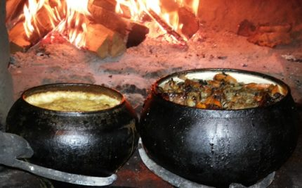 Cast iron with food in a Russian oven