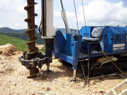 Auger well drilling