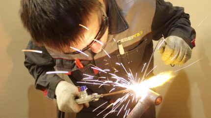 Welder processes a gas pipe