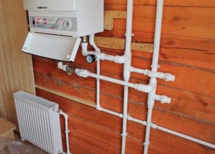 Connexion d'une chaudière à gaz murale aux communications