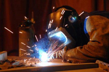 Welder conducts hot work