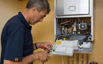 Réparation d'une chaudière à gaz par un gasman
