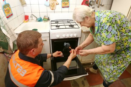 Gas service worker checks the stove