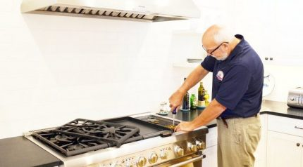 Specialist mends a gas stove