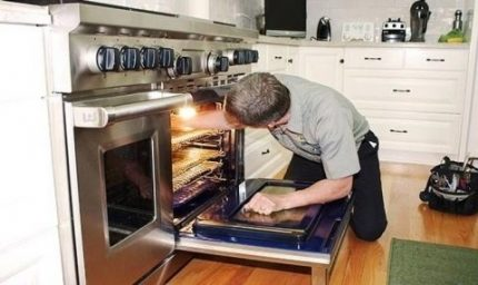 The master repairs the oven