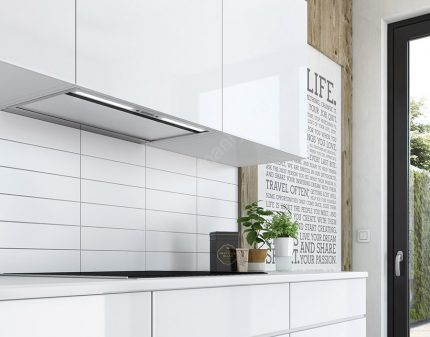 Cooker hood integrated in the kitchen