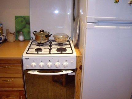 Gas stove next to the refrigerator