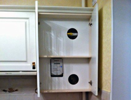 Installing a gas meter in a double bottom cabinet