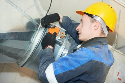 A specialist examines the duct using special video equipment