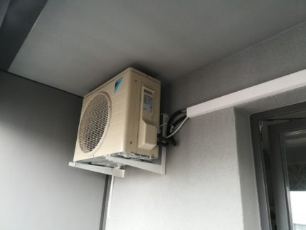 Outdoor unit on an open balcony
