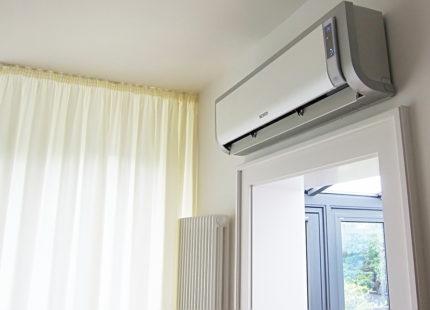 Rectangular air conditioner above the doorway