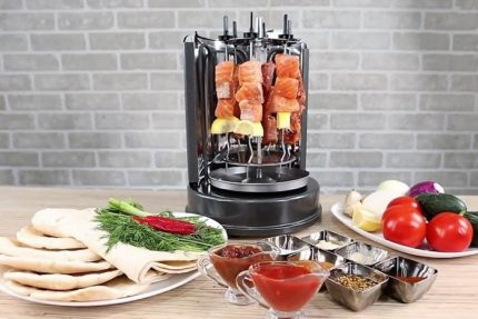 Vertical electric skewer on the table