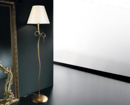 Floor lamp with a metal base and a glass shade